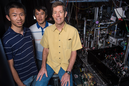 Physicists (from left) De Luo, Jason Nguyen and Randy Hulet observed a strange disappearing act during collisions between forms of Bose Einstein condensates called solitons. In some cases, the colliding clumps of matter appear to keep their distance even as they pass through each other. Credit: Jeff Fitlow