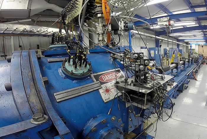 The large-bore, two-stage gas gun at Los Alamos National Laboratory uses highly-compressed light gas to fire a projectile into a high-explosive sample to precisely measure shock waves as they travel through the material.