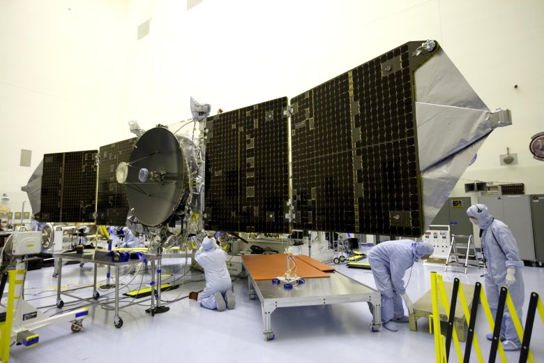 Inside the Payload Hazardous Servicing Facility at NASA's Kennedy Space Center, engineers and technicians test deploy the twin solar arrays on the Mars Atmosphere and Volatile Evolution, or MAVEN, spacecraft. Positioned in an orbit above the Red Planet, MAVEN will study the upper atmosphere of Mars in unprecedented detail. Image Credit: NASA/Kim Shiflett