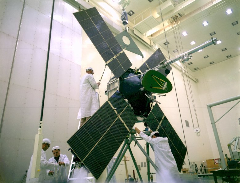 The Mariner 4 spacecraft was assembled by engineers and technicians at the Jet Propulsion Laboratory in Pasadena, California. It is seen here being prepared for a weight test on Nov. 1, 1963. Image Credit: NASA/Jet Propulsion Laboratory