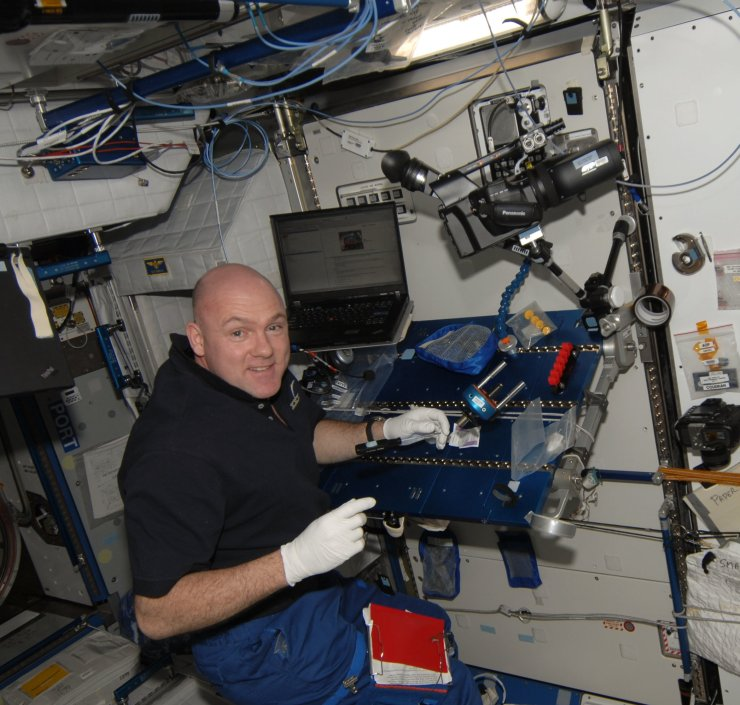 European Space Agency astronaut Andre Kuipers works with the 3-D camera on the International Space Station during Expedition 31 in 2012. Image Credit: NASA