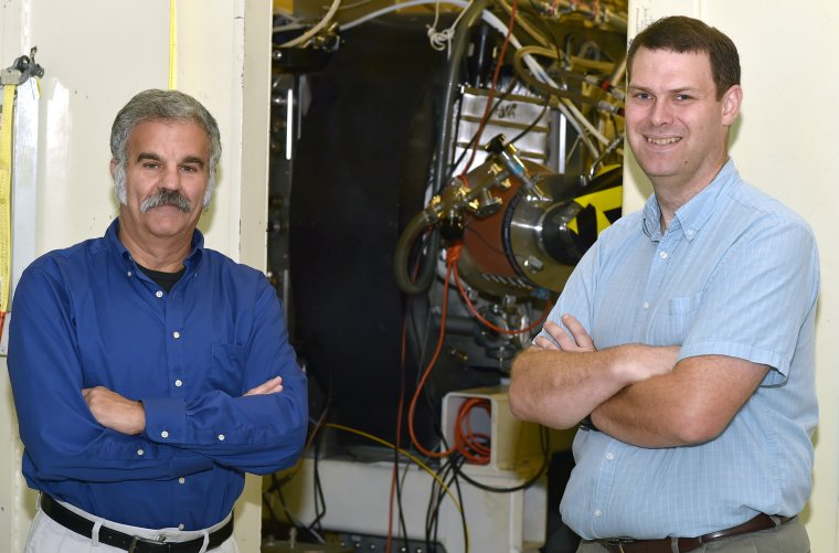 "Dr. John Sethian (left) and Dr. Matt Wolford (right) of the U.S. Naval Research Laboratory have partnered with a power company to see if they can reduce NOx emissions with high-energy pulses from an electron beam. ""We could probably have something ready to field in about two years,"" says Sethian.  (Photo: U.S. Naval Research Laboratory/Jamie Hartman)"