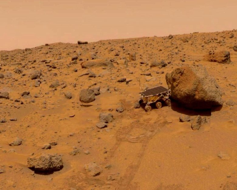 On July 21, 1997, the Mars Pathfinder's Sojourner rover takes its Alpha Particle X-ray Spectrometer measurement on a rock near the landing site. Image Credit: NASA/Jet Propulsion Laboratory