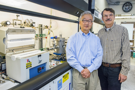 """Luke Lee (left) and Alex Zettl led the creation of the world's first graphene nanopores with a """"built-in"""" optical antenna. (Photo by Roy Kaltschmidt)"""