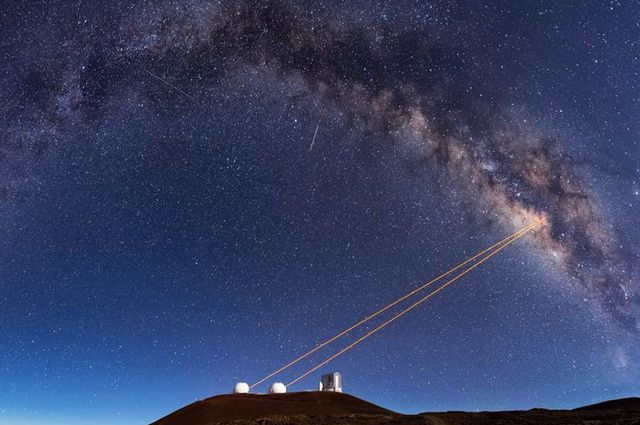 Telescopes at the Keck Observatory use adaptive optics, which enabled UCLA astronomers to discover that G2 is a pair of binary stars that merged together. Image credit: Ethan Tweedie