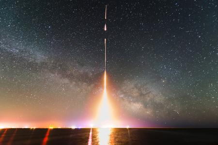 A time-lapse photograph of the CIBER rocket launch, taken from NASA's Wallops Flight Facility in Virginia in 2013. This was the last of four launches of the Cosmic Infrared Background Experiment (CIBER). Sub-orbital rockets are smaller than those that boost satellites to orbit, and are ideal for making quick astronomy observations above Earth's atmosphere. This photo shows a time-lapse capture of the first three stages of the Black Brant XII class rocket at the time of launch. Credit: T. Arai/University of Tokyo