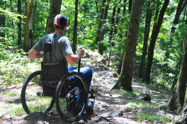 The Freedom Chair enables mobility on uneven terrain. Photo courtesy of GRIT.