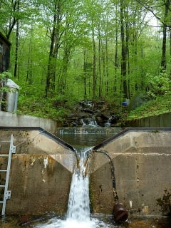 This weir, a place in a stream where a wall controls the flow of water, measures stream flow and dissolved chemical exports from Watershed 3 at the Hubbard Brook Experimental Forest in New Hampshire, where the research took place.