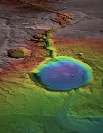 Warmth and flowing water? Although the surface is now cold and desiccated, in early Mars history water formed an open-basin lake, filling the crater, forming a delta, and breaching the lower rim as water flowed to lower elevations (blue). NASA/Mars Reconnaissance Orbiter Rendering by James Dickson, Brown University