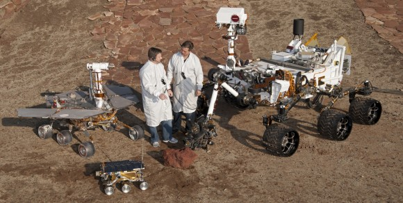 The future Chinese rover would be nearly as large as the MER rovers. Full scale models of all three NASA/JPL Mars rovers are shown here – Mars Pathfinder, MER and MSL in a JPL Mars yard with engineers. (Photo Credit: NASA/JPL)