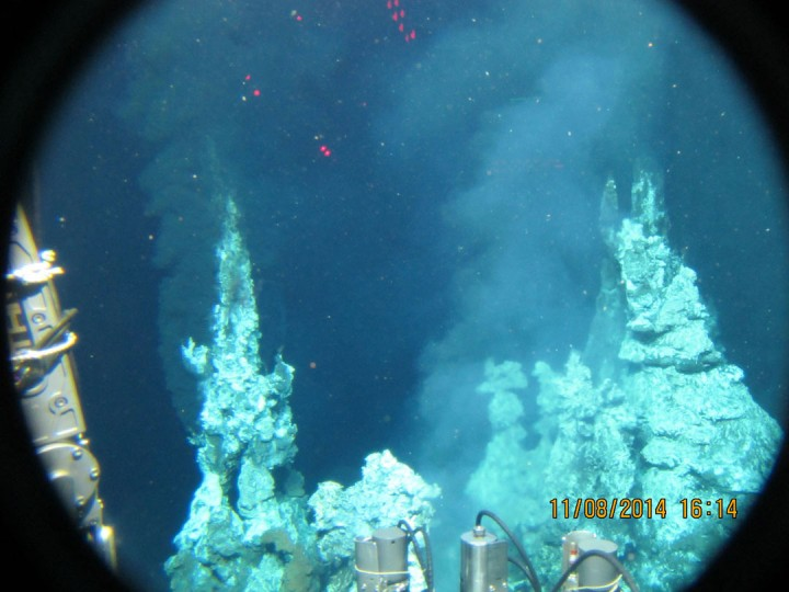 """Black smokers White and black pillars a couple of stories high, """"black smokers"""" are mineral formations composed of the sulfides and iron that precipitate from the boiling water welling up from the vents.  Photo: Jeremy Rich, ©Woods Hole Oceanographic Institution"""
