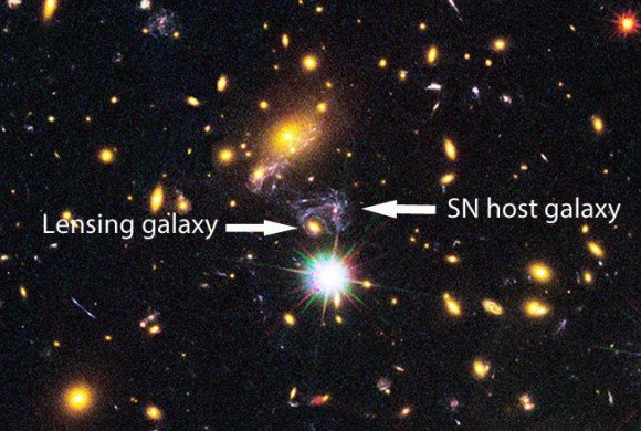 This cropped image shows the central slice of the MACS J1149 galaxy cluster. A massive elliptical galaxy lenses the light of SN Refsdal into four separate images. It also distorts the purplish spiral galaxy that's host to the supernova. Credit: NASA/ESA/M. Postman STScI/CLASH team