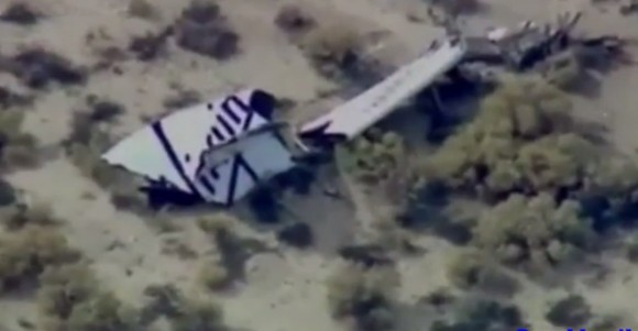 One of two tail sections (empennage) of SpaceShipTwo lies on the Mojave desert moments after its breakup during test flight. (Credit: Mojave Rescue & Emergency Response Team)