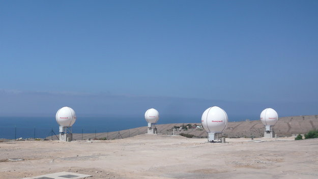 The ESA-built Maspalomas Medium-Earth Orbit Local User Terminal (MEOLUT) on Gran Canaria, the largest island of Spain's Canary Islands, part of an extension of the international Cospas–Sarsat search and rescue programme into medium-altitude orbits, spearheaded by Galileo. Each site is equipped with four antennas to track four satellites. There are three sites in all, forming a triangle around Europe: Maspalomas, Spitsbergen in the Norwegian Arctic and Larnaca in Cyprus. These three sites are monitored and controlled from the Search and Rescue Ground Segment Data Service Provider site, at Toulouse in France. The stations are networked to share raw data, effectively acting as a single huge 12-antenna station, achieving unprecedented detection time and localisation accuracy in relaying search and rescue signals to local authorities. Copyright ESAS-Fermin Alvarez Lopez