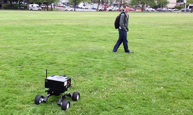 A robot equipped with a camera follows a researcher by tracking him as he walks. Image credit: University of Washington