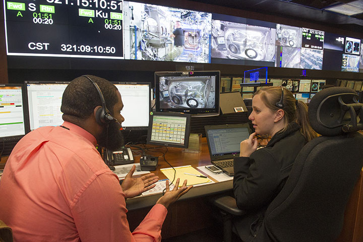 """Darian Bryant, left, and Melissa Hopper, stowage engineers with the Payload Operations Integration Center at NASA's Marshall Space Flight Center in Huntsville, Alabama, work with NASA astronaut Barry """"Butch"""" Wilmore to calibrate the first 3-D Printer flown on the International Space Station. Image Credit: NASA/MSFC/Emmett Given"""