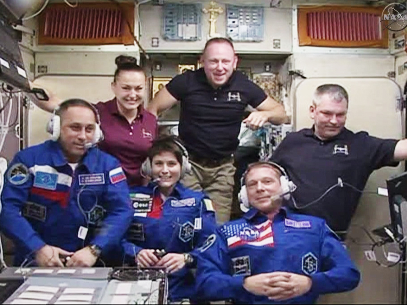 In the front row, from left are the newest Expedition 42 crew members Anton Shkaplerov, Samantha Cristoforetti and Terry Virts. In the back are Elena Serova, Commander Barry Wilmore and Alexander Samokutyaev. They are in the Zvezda service module for a traditional crew greeting ceremony with family and mission officials on the ground. Credit: NASA TV