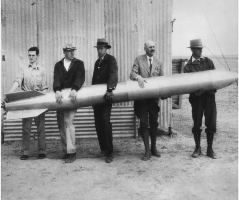 Dr. Robert H. Goddard (second from right) and his colleagues hold a liquid-propellant rocket in 1932 at their New Mexico workshop. Credit: NASA Goddard Space Flight Center