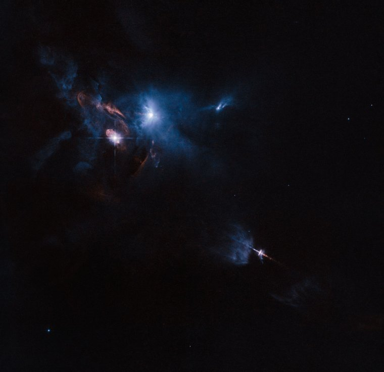 The NASA/ESA Hubble Space Telescope has snapped a striking view of a multiple star system called XZ Tauri, its neighbour HL Tauri and several nearby young stellar objects. XZ Tauri is blowing a hot bubble of gas into the surrounding space, which is filled with bright and beautiful clumps that are emitting strong winds and jets. These objects illuminate the region, creating a truly dramatic scene. Credit: Image credit: ESA/Hubble and NASA Acknowledgement: Judy Schmidt