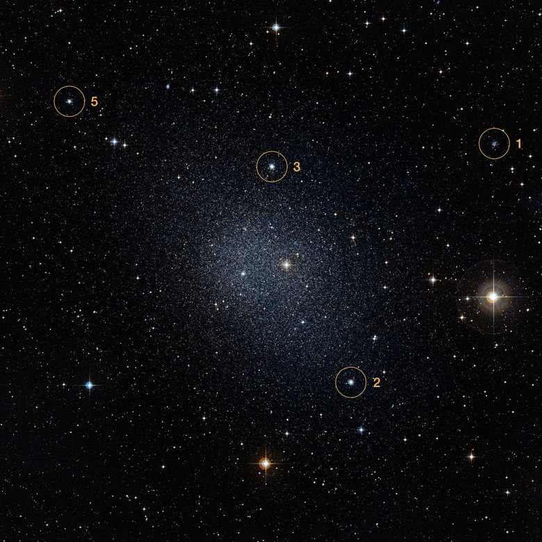 This is a Digitized Sky Survey 2 image of the dwarf galaxy Fornax. Highlighted here are four globular clusters found in the galaxy called Fornax 1, 2, 3 and 5. Credit: ESO/Digitized Sky Survey 2