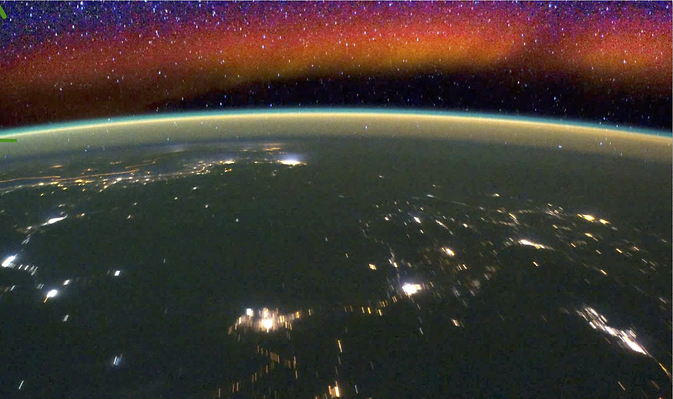 NASA's new ICON mission will study what causes variation in airglow such as the red glowing band seen in the atmosphere in this image from the International Space Station. Such emissions point to disturbances that can interfere with radio communications. Image Credit: NASA