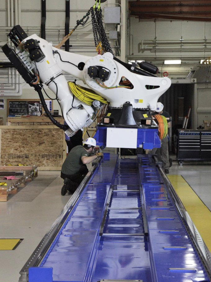The crane returned two weeks later so the 21-foot tall robot arm could be placed on the track. The robot head will make large composite pieces by sliding up and down the track laying down epoxy and carbon fibers in precise patterns. Image Credit: NASA/David C. Bowman