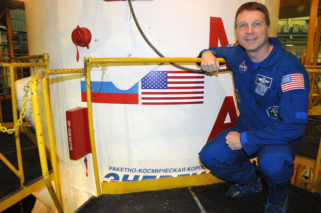 Terry Virts of NASA poses for a picture Nov. 19 by the Soyuz booster that will send the Soyuz TMA-15M spacecraft into orbit. Credit: NASA/Viktor Ivanov