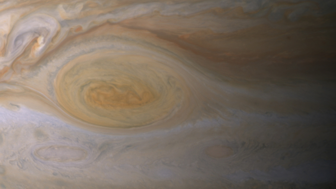 Research suggests effects of sunlight produce the color of Jupiter's Great Red Spot. The feature's clouds are much higher than those elsewhere on the planet, and its vortex nature confines the reddish particles once they form. Image Credit: NASA/JPL-Caltech/ Space Science Institute