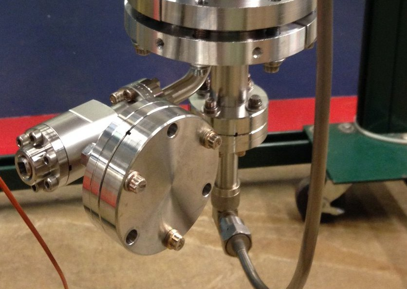 A team from the Accelerator Division has successfully powered this small SRF cavity with a magnetron. Now they aim to power a large, application-specific model. Photo: Brian Chase, AD