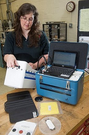 NASA materials engineer Miria Finckenor prepares to use a spectroreflectometer to analyze the reflectivity of coating samples. Image Credit: NASA