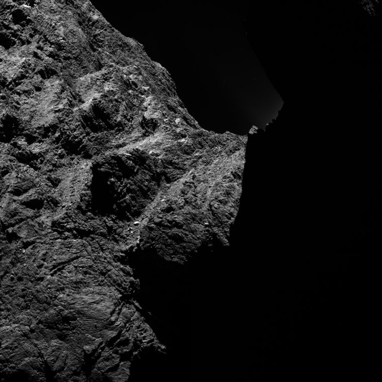 This image of comet 67P/Churyumov-Gerasimenko was obtained on October 30, 2014 by the OSIRIS scientific imaging system on the Rosetta spacecraft. The right half is obscured by darkness. The image was taken from a distance of approximately 18.6 miles (30 kilometers). Image Credit: ESA/Rosetta/MPS for OSIRIS Team