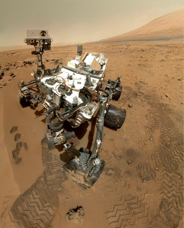NASA's Curiosity rover used the Mars Hand Lens Imager to capture this selfie. Taken on Oct. 31, 2012, it shows the rover at the site where the mission's first scoop sampling took place. Image Credit: NASA/Jet Propulsion Laboratory-Caltech