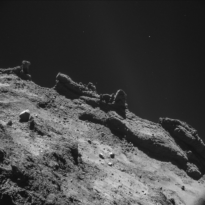 A jagged horizon of the nucleus of comet 67P/Churyumov-Gerasimenko appears in this image taken by the navigation camera on the European Space Agency's Rosetta spacecraft during the second half of October 2014. The image was taken from a distance of less than 6 miles (10 kilometers) from the surface. Image Credit: ESA/Rosetta/NAVCAM