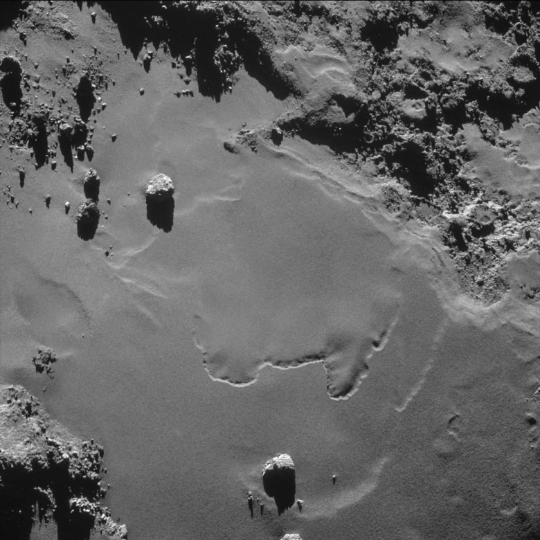 A patch of relatively smooth ground on the nucleus surface of comet 67P/Churyumov-Gerasimenko appears in this image taken by the navigation camera on the European Space Agency's Rosetta spacecraft in October 2014. The image was taken from a distance of less than 6 miles (10 kilometers). Image Credit: ESA/Rosetta/NAVCAM