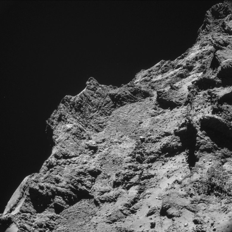 Some relatively rough terrain on the nucleus of comet 67P/Churyumov-Gerasimenko appears in this image taken by the navigation camera on the European Space Agency's Rosetta spacecraft in the second half of October 2014. The image was taken from a distance of less than 6 miles (10 kilometers). Image Credit: ESA/Rosetta/NAVCAM
