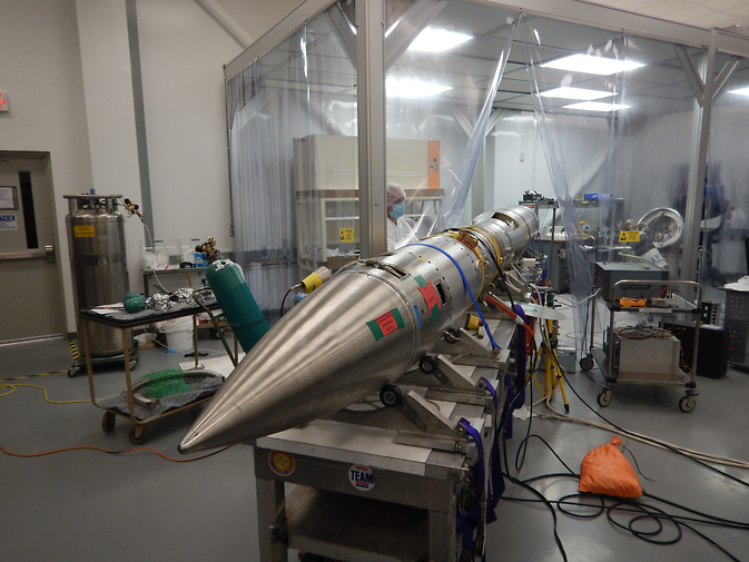 The Rapid Acquisition Imaging Spectrograph Experiment is seen peeking out of a clean room during the weeks of testing before its scheduled November 2014 launch. Image Credit: NASA/RAISE