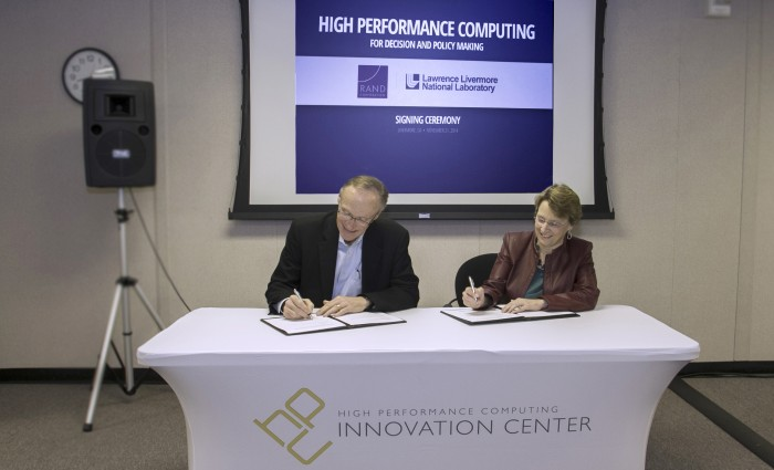 Lawrence Livermore Science and Technology Deputy Director Greg Suski and Susan Marquis, RAND vice president, Emerging Policy Research and Methods and dean of the Pardee RAND Graduate School, sign a memorandum of understanding to expand the use of high performance computing (HPC) in decision analysis and policymaking. Photo by Julie Russell/LLNL