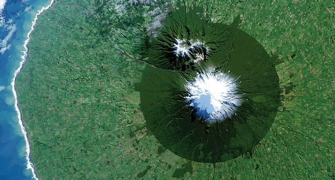 In July 2014, Landsat 8 captured the isolated island of protected forest around New Zealand's Mt. Taranaki in Egmont National Park surrounded by once-forested pasturelands. Image Credit: NASA/USGS