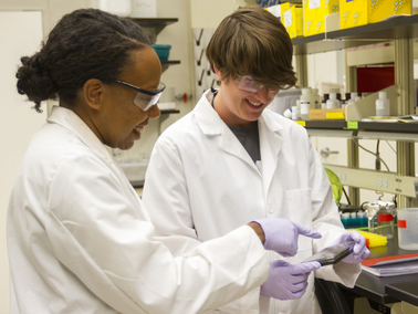 Karmella Haynes (left) is leading research to explore the capability of genetically engineered proteins to reactivate tumor suppressors inside body cells to prevent the onset of cancer, or arrest its development. Photo by: Jessica Hochreiter/ASU