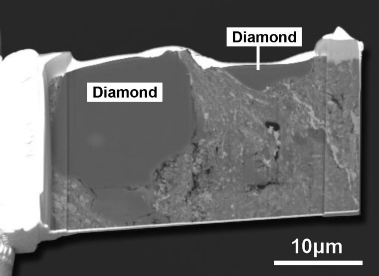 This is a secondary electron image of two large diamond crystals in the matrix of the Sutter's Mill number SM2 meteorite, as prepared by a focused ion beam. The origin of the diamonds is something of a mystery since they are considerably larger than those found in any chondritic meteorites. Image Credit: NASA Johnson/M. Zolensky
