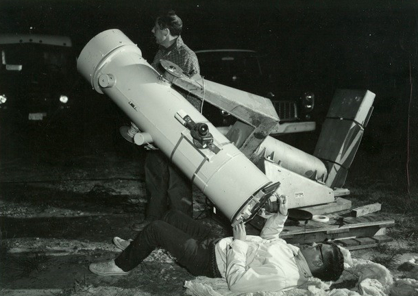 An early satellite laser ranging experiment in which scientists point and focus the Mobile Optical Telescope System camera along the Beacon Explorer satellite track to record the laser returns. Image Credit: Courtesy of John Degnan