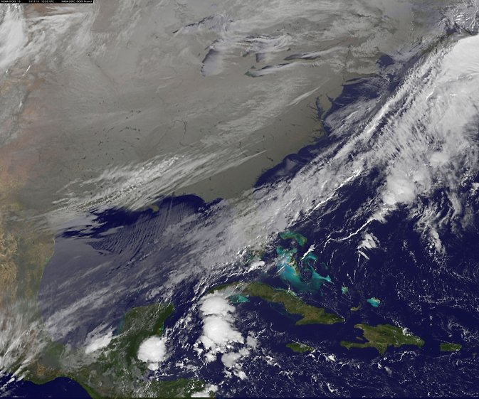 In this NOAA's GOES satellite infrared image taken on Nov. 18 at 7:30 a.m. EST, the cold air over the central and eastern U.S. appears to look like a blanket of white, but it's not all snow. Image Credit: NASA/NOAA GOES Project, Dennis Chesters