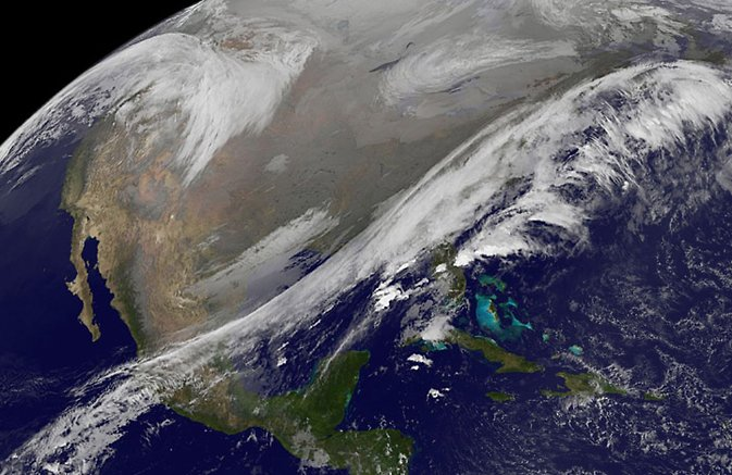 This NOAA's GOES satellite infrared image taken on Nov. 25 at 11:45 UTC (6:45 a.m. EST) shows two main weather systems over the U.S. Image Credit: NASA/NOAA GOES Project
