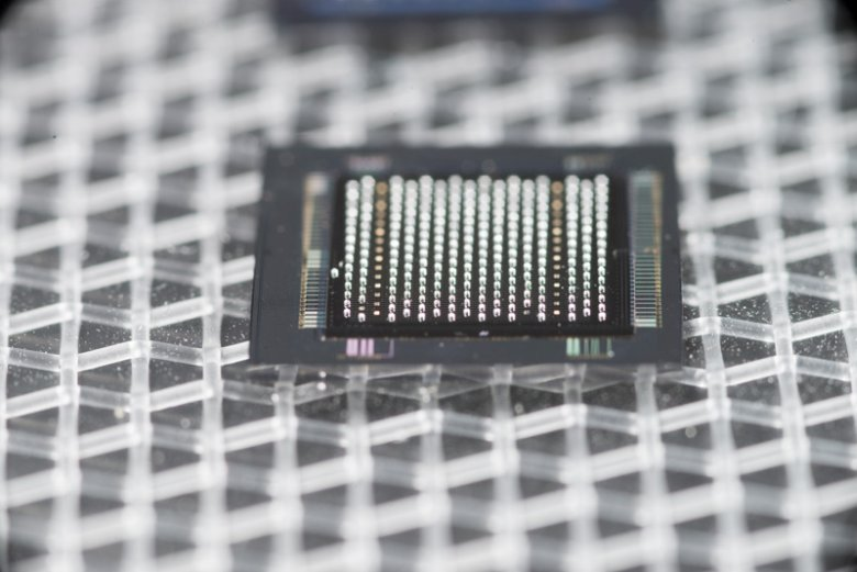 The 64-by-64 pixel VIPIC prototype, pictured with a sensor on the bottom and solder bump-bonding bump on top, ready to be received on the printed circuit board. Photo: Reidar Hahn