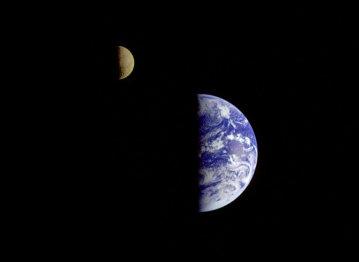 On Sept. 18, 1977, Voyager 1 took three images of the Earth and Moon that were combined into this one image. The moon is artificially brightened to make it show up better. Credit: NASA