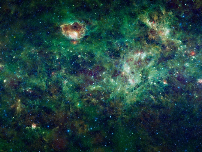 This enormous mosaic of the Milky Way galaxy from NASA's Wide-field Infrared Survey Explorer, or WISE, shows dozens of dense clouds, called nebulae. Many nebulae seen here are places where new stars are forming, creating bubble like structures that can be dozens to hundreds of light-years in size. Image Credit: NASA