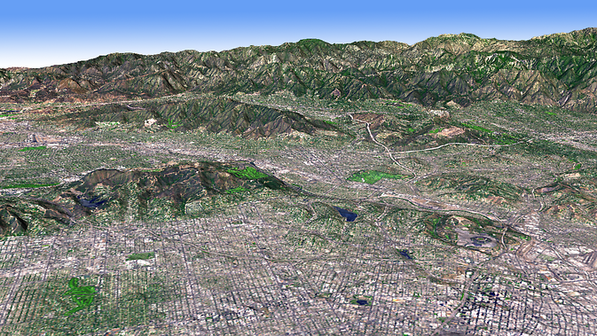 Los Angeles Basin bordered on the north by the San Gabriel Mountians. ASTER's simulated natural color image, collected Aug 15, 2006, is draped over the ASTER Global Digital Elevation Model. Image Credit: NASA/JPL/METI, ASTER Team 14