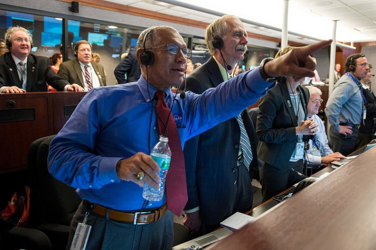 NASA Administrator Charles Bolden and William Gerstenmaier, Associate Administrator for NASA's Human Exploration and Operations Directorate, and others in Building AE at Cape Canaveral Air Force Station in Florida monitor the Orion spacecraft as it returns to Earth and splashes down in the Pacific Ocean. Image Credit: NASA/Bill Ingalls