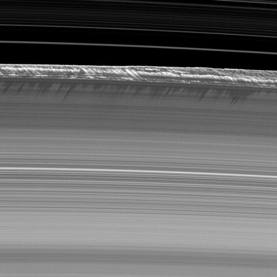 Vertical structures cause shadows on Saturn's B ring in this July 2009 picture from the Cassini spacecraft. Credit: NASA/JPL/Space Science Institute