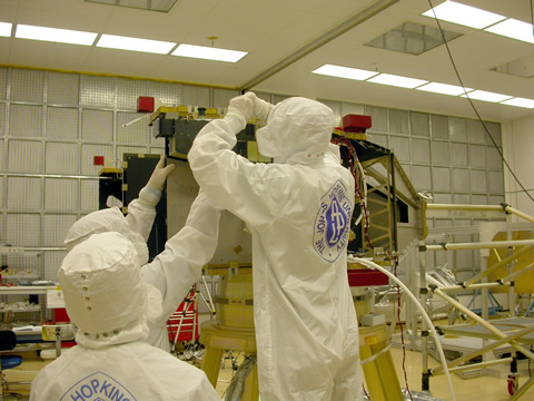Attaching Alice: Technicians at the Johns Hopkins University Applied Physics Laboratory in Laurel, Maryland, install the Alice ultraviolet imaging spectrometer on New Horizons several months before the spacecraft's 2006 launch toward the Pluto system.